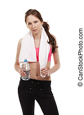 young fitness woman with a towel and a bottle of water on white background