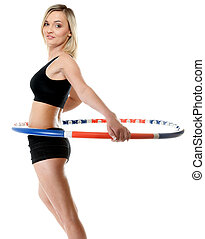 young fitness woman with hula hoop isolated - young sporty...
