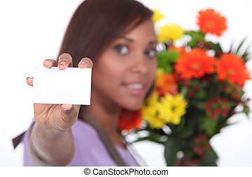 young florist showing business card