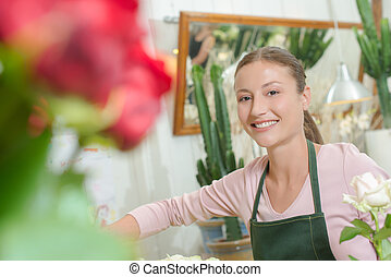 Young florist wearing an apron