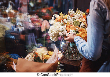 Young florist with flowers