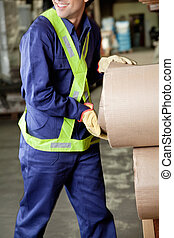 Young Foreman Working At Warehouse - Midsection of young...