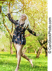 Young Forest Nymph Dancing in Blossom Spring Forest
