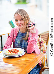 Young French woman having lunch