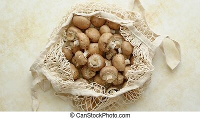 Young fresh Champignons in a ecological zero-waste net bag ...