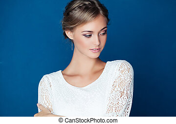 Young friendly woman on blue background. Young Beauty
