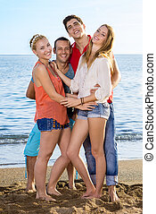 Young Friends Enjoying at the Beach - Full Length of Young...