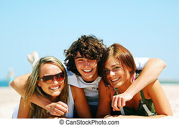 Young friends on the summer beach