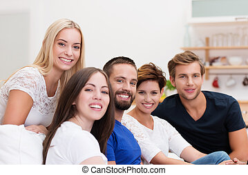 Young friends relaxing at home - Group of young men and...
