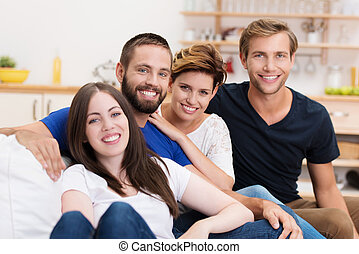 Young friends relaxing at home - Group of diverse young...
