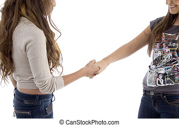 young friends shaking hands