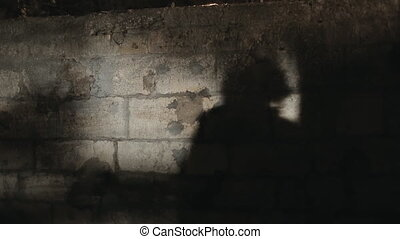 Young frightened woman running away from the threatening pursuer