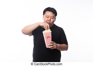 Young Funny Fat Asian man eating popcorn isolated on white background, Unhealthy concept