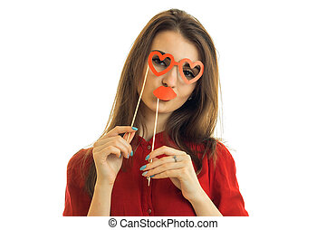 young funny girl with paper lips and glasses in shape of...