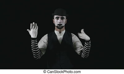 Young funny mime changing facial expressions