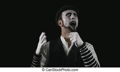 Young funny singing mime singing and being deafened by a megaphone
