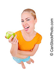 Young funny woman eat green apple