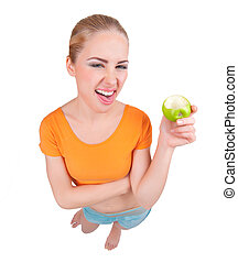 Young funny woman with apple