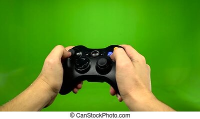 Young game player hands controlling joystick keys playing on...