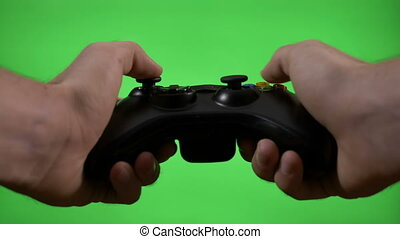 Young game player hands controlling joystick keys playing...