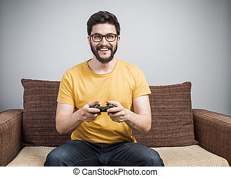 Young gamer on sofa