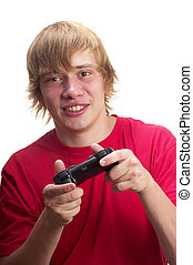 Young gamer - Young teenage boy gamer with gamepad in the...