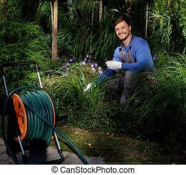 Young gardener working in a garden