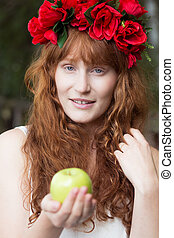 Young ginger woman with red flowers