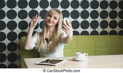 Young girl 20s making selfie photo on smartphone