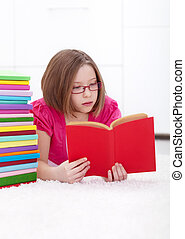 Young girl absorbed by reading