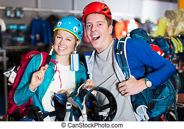 girl and guy show travel gear