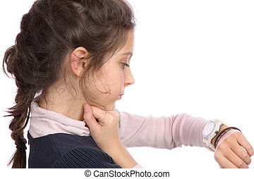 Young girl and watch - Young girl looking at her watch on a...