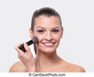 Young girl apply makeup