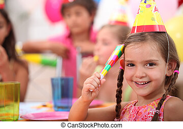 Young girl at a birthday party