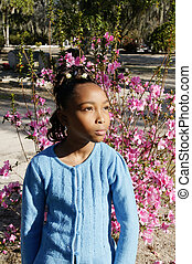 Young Girl at a Cemetary - An African-American girl at a...