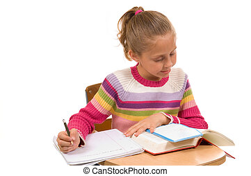 Young Girl at desk in school on whi