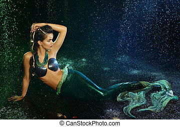 Young girl at the image of mermaid