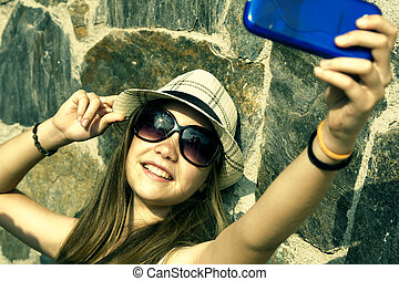 selfie - young girl becoming a selfie with instagram style...