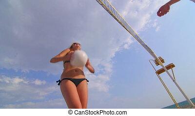Young girl beginner play beach volleyball