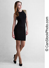 Young girl blonde in black short dress to utmost high-heeled