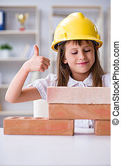 Young girl building with construction bricks