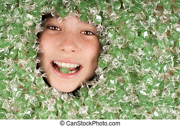 young girl buried on green candies