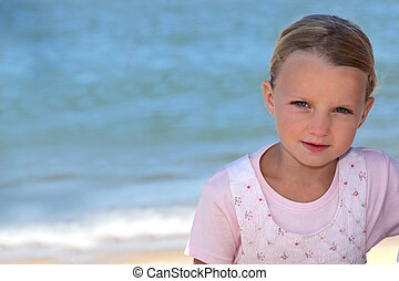 Young girl by the sea
