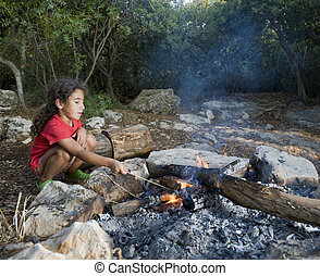 young girl campfire - young girl in a campfire min a...
