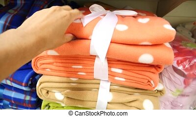 Young girl choosing bath towels textile in apparel clothes...