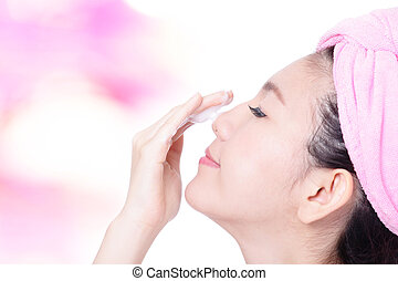 Young Girl Clean Face with foam on hand on pink background,...