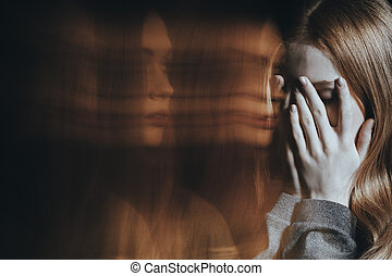 Young girl crying with schizophrenia