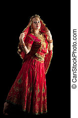 young girl dance in red indian oriental costume
