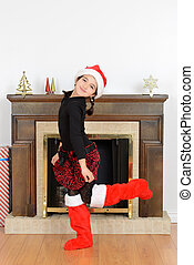 Young girl dancing front fireplace