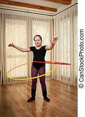 Young girl dancing with hoop